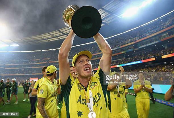 James Faulkner of Australia celebrates with the trophyduring the 2015 ICC Cricket World Cup final match between Australia and New Zealand at...