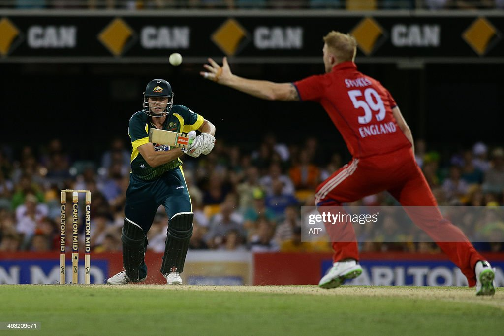 James Faulkner of Australia hits past Ben Stokes of England during the second one-day international cricket match between Australia and England at the Gabba in Brisbane on January 17, 2014. Australia are chasing England's total of 300 runs. AFP PHOTO / John PRYKE USE--