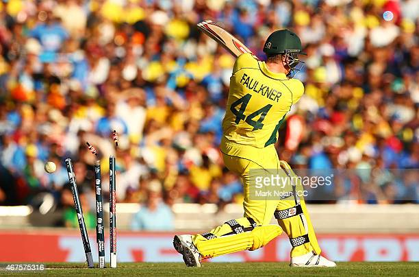 James Faulkner of Australia is bowled during the 2015 Cricket World Cup Semi Final match between Australia and India at Sydney Cricket Ground on...