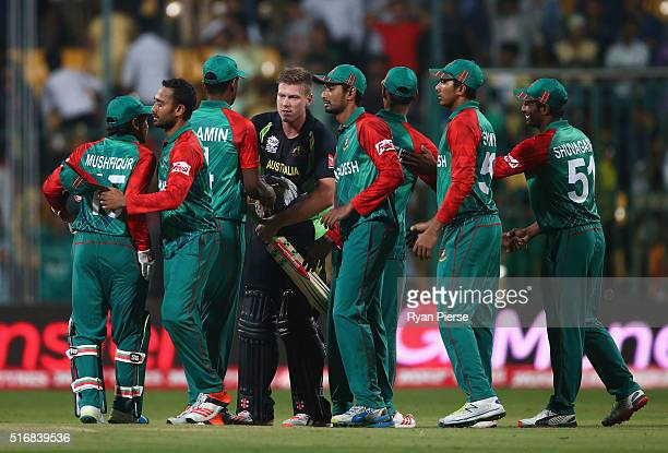James Faulkner of Australia is congratulted by the Bangadesh team after hitting the winning runs during the ICC World Twenty20 India 2016 Super 10s...