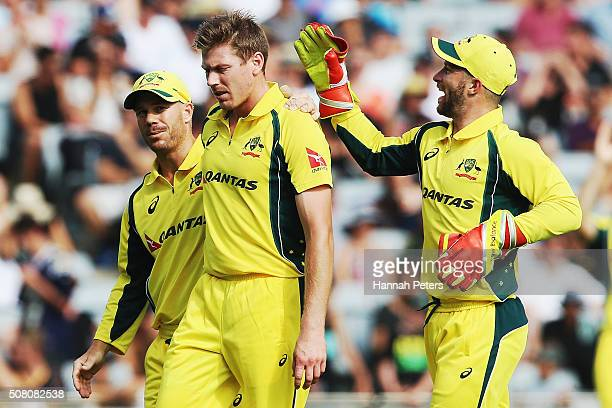 James Faulkner of Australia Ish Sodhi of the Black Caps congratulated by David Warner and Matthew Wade of Australia after claiming the wicket of Adam...