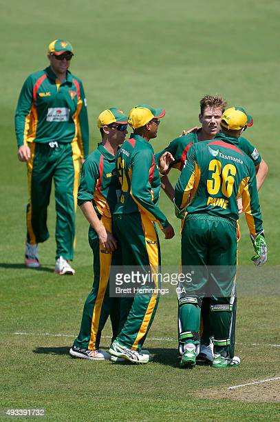 James Faulkner of Tasmania celebrates after taking the wicket of Matthew Wade of Victoria during the Matador BBQs One Day Cup match between Tasmania...
