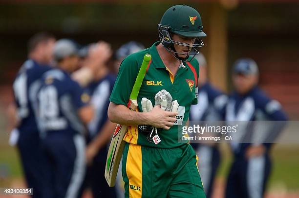 James Faulkner of Tasmania leaves the field after being dismissed by John Hastings of Victoria during the Matador BBQs One Day Cup match between...