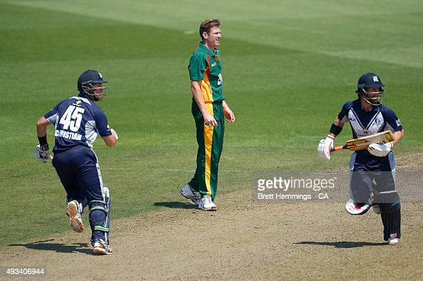 James Faulkner of Tasmania looks on as Matthew Wade and Daniel Christian of Victoria run between the wicket during the Matador BBQs One Day Cup match...