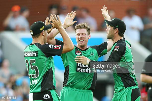 James Faulkner of the Melbourne Stars celebrates with teammates after getting the wicket of Mahela Jayawardene of the Adelaide Strikers during the...