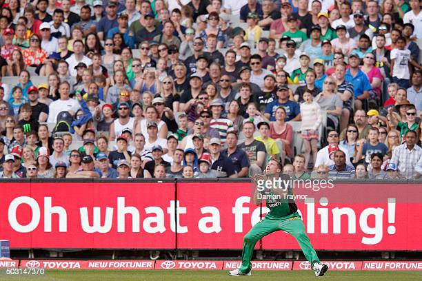 James Faulkner of the Melbourne Stars takes a catch to dismiss Tom Cooper of the Melbourne Renegades during the Big Bash League match between the...