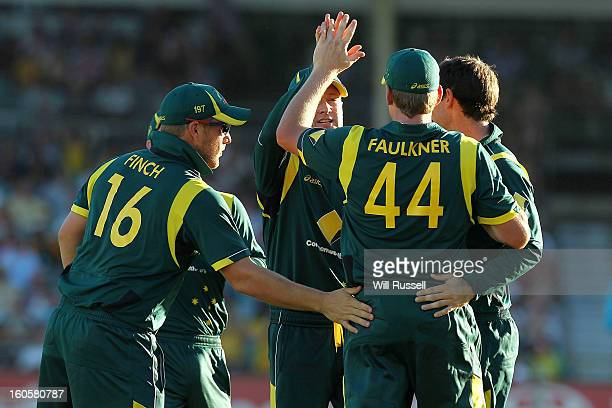 James Faulknerof Australia is congratulated by teammates after taking a catch off Darren Sammy of the West Indies during game two of the Commonwealth...