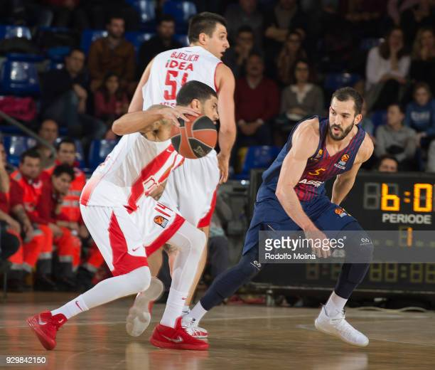 James Feldeine #14 of Crvena Zvezda mts Belgrade competes with Pau Ribas #5 of FC Barcelona Lassa during the 2017/2018 Turkish Airlines EuroLeague...