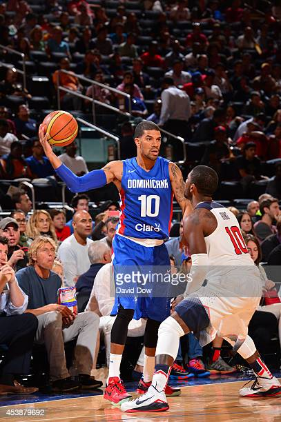 James Feldeine of the Dominican Republic National Team passes against Kyrie Irving of the USA Basketball Men's National Team on August 20 2014 at...