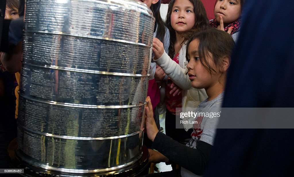 James Finney-Jules takes a close look at the Stanley Cup during a visit to Sk'elep School of Excellence for a visit on Day 2 of 2016 Scotiabank Hockey Day in Canada on February 5, 2016 in Kamloops, British Columbia, Canada.