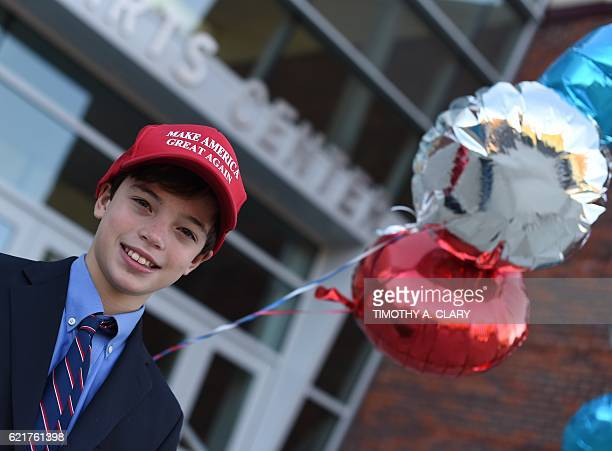 James Fiore wears his Donald Trump while accompanying his mother to cast her ballot for president at the Greenwich High School polling place in...
