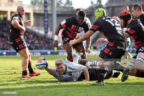 James Fish of Northampton Saints dives over to score his side's fifth try during the Heineken Champions Cup Round 6 match between Lyon Olympique...
