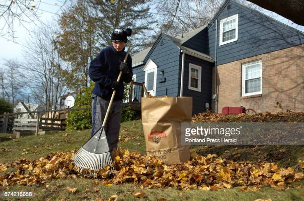 James Fletcher rakes leaves outside of his house in Portland on Sunday November 12 2017 James' father Chris Fletcher says they usually rake about 25...