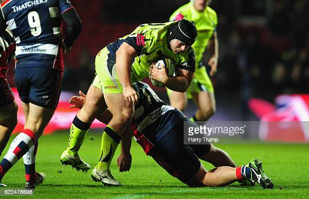 James Flynn of Sale Sharks is tackled by Marc Jones of Bristol Rugby during the AngloWelsh Cup match between Bristol Rugby and Sale Sharks at Ashton...