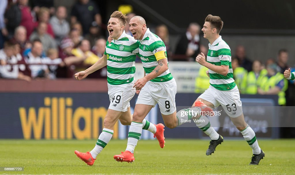 James Forrest celebrates his goal with Scott Brown of Celtic of during the Ladbrokes Scottish Premiership match between Hearts and Celtic on August 7, 2016 in Glasgow, Edinburgh.
