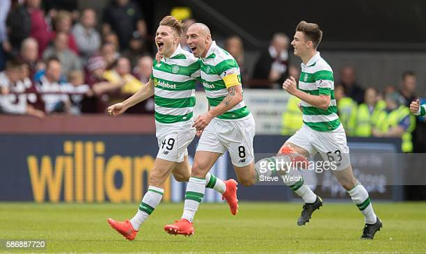 James Forrest celebrates his goal with Scott Brown of Celtic of during the Ladbrokes Scottish Premiership match between Hearts and Celtic on August 7...