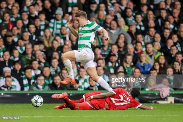 James Forrest of Celtic and David Alaba of Bayern Munich battle for the ball during the UEFA Champions League group B match between Celtic FC and...