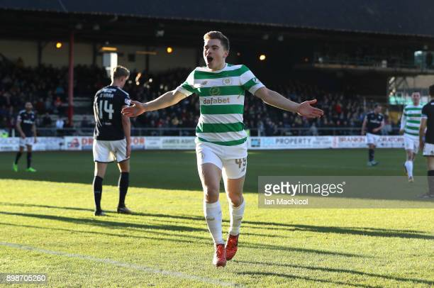 James Forrest of Celtic celebrates after scoring the opening goal during the Scottish Premier League match between Dundee and Celtic at Dens Park on...