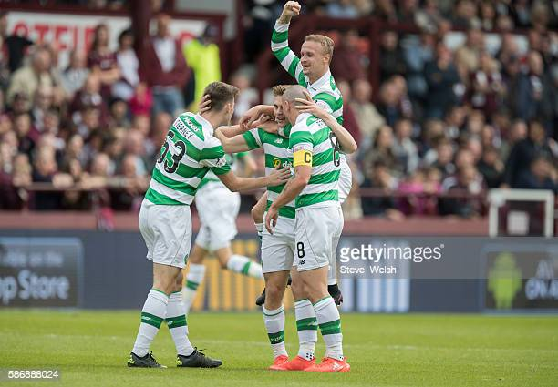 James Forrest of Celtic celebrates his goal with his teammates during the Ladbrokes Scottish Premiership match between Hearts and Celtic on August 7...