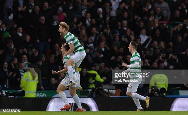 James Forrest of Celtic celebrates scoring the opening goal of the game with his team mates during the Betfred League Cup Final between Celtic and...