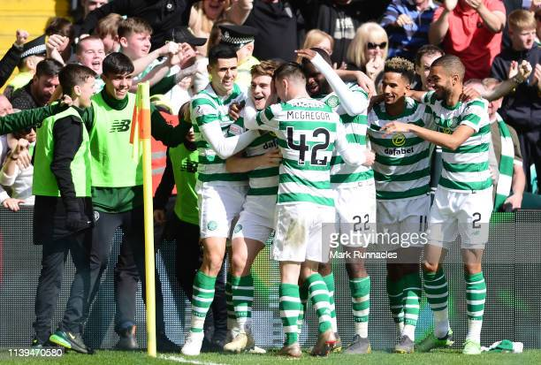 James Forrest of Celtic celebrates with his team mates after he scores his side second goal during the Ladbrokes Scottish Premiership match between...