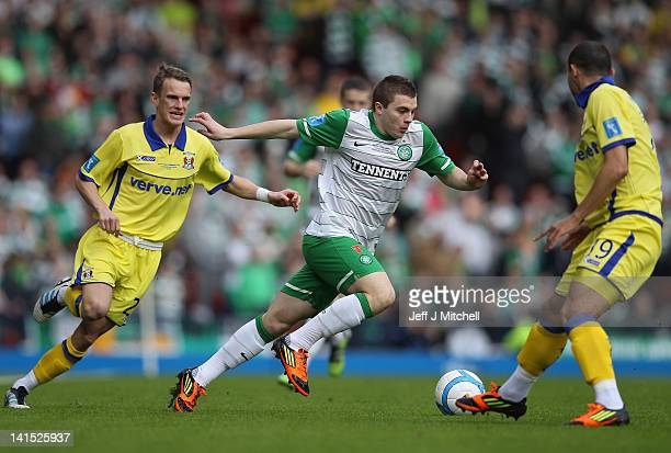 James Forrest of Celtic goes past Dean Shiels and Dasnny Buijs of Kilmarnock during the Scottish Communities League Cup Final between Celtic and...