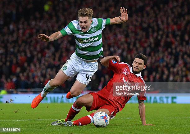James Forrest of Celtic is challenged in the penalty box by Anthony O'Conner of Aberdeen resting in a penalty to Celtic during the Betfred Cup Final...