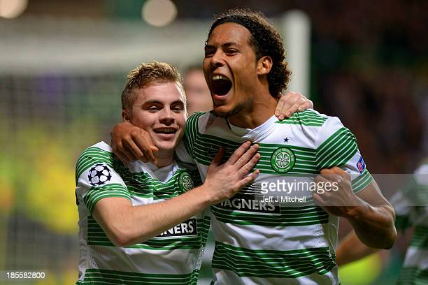James Forrest of Celtic is congratulated by teammate Virgil van Dijk of Celtic after scoring the opening goal from the penalty spot during the UEFA...