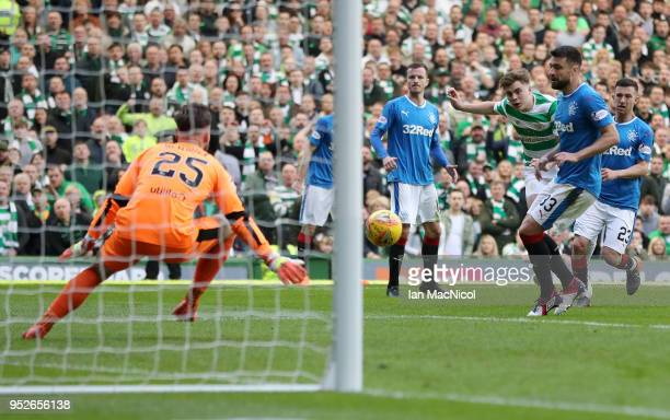 James Forrest of Celtic scores his sides third goal during the Scottish Premier League match between Celtic and Rangers at Celtic Park on April 29...