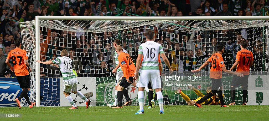 James Forrest of Celtic scores the winning goal during the UEFA Champions League Play Off Round Second Leg match between Celtic and FC Shakhter Karagandy at Celtic Park Stadium on August 28, 2013 in Glasgow, Scotland.