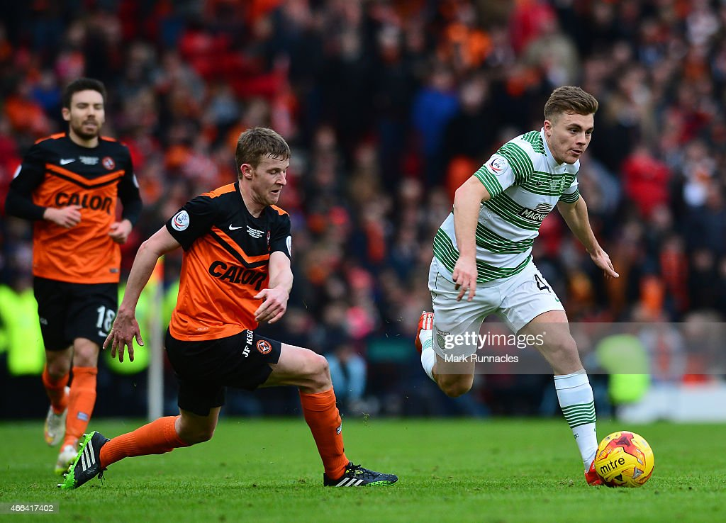 James Forrest of Celtic takes on Paul Dixon of Dundee United during the Scottish League Cup Final between Dundee United and Celtic at Hamden Park on March 15, 2015 in Glasgow Scotland.