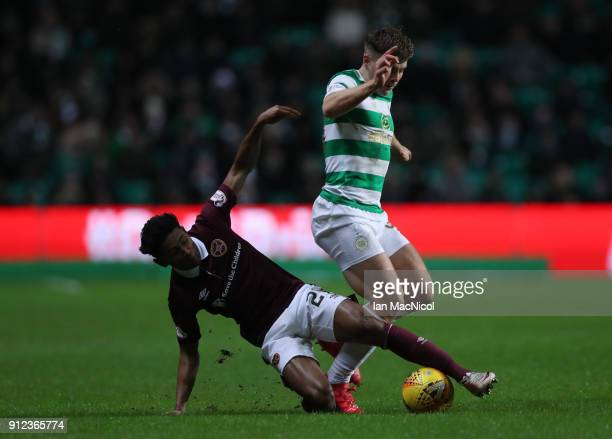 James Forrest of Celtic vies with Demi Mitchell of Heart of Midlothian during the Scottish Premier League match between Celtic and Heart of...