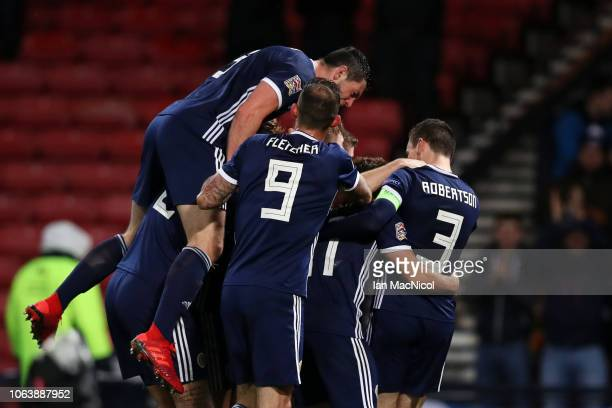 James Forrest of Scotland celebrates with team mates after scoring his team's third goal during the UEFA Nations League C group one match between...