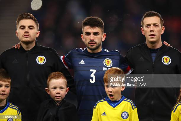 James Forrest of Scotland, Greg Taylor of Scotland and Callum McGregor of Scotland line up for the national anthems during the UEFA Euro 2020...