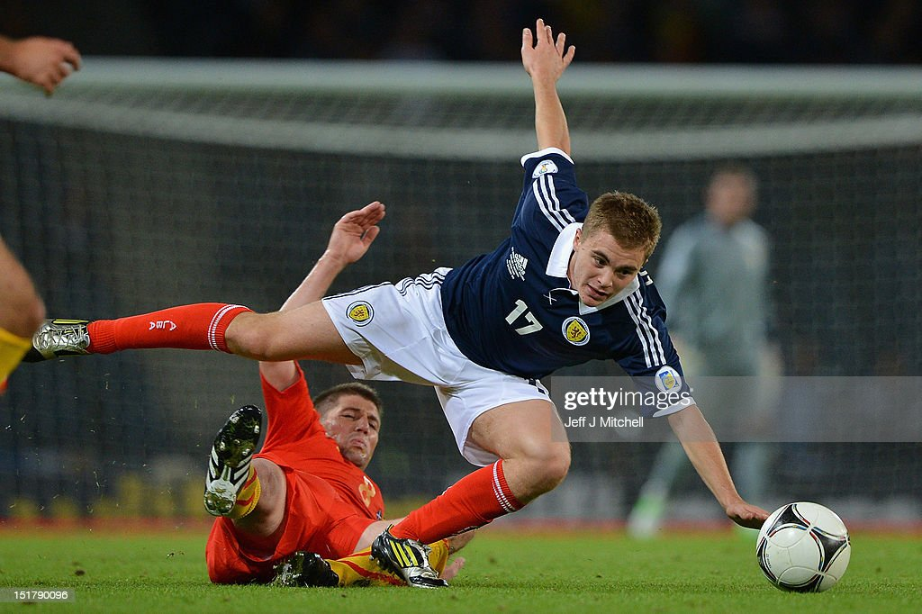 James Forrest of Scotland tackles Veliche Shumulikoski of Macedonia during the FIFA World Cup Qualifier Between Scotland and Macedonia at Hampden Park on September 11, 2012 in Glasgow, Scotland.