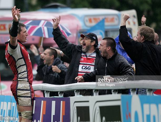 James Forrester of Gloucester celebrates scoring the winning try in extra time with the Gloucester fans during the European Challenge Cup Final match...