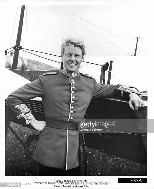 James Fox leaning against his plane in a scene from the film 'Those Magnificent Men In Their Flying Machines Or How I Flew From London To Paris In 25...