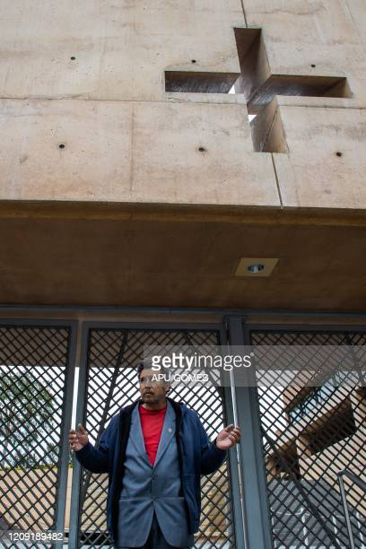 James Francis prays outside of the Cathedral of Our Lady of the Angels which is closed to the public during the Palm Sunday on April 5, 2020 in Los...