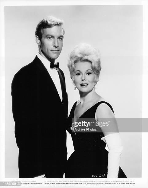 James Franciscus and Eva Gabor standing together in a scene from the film 'Youngblood Hawke' 1964
