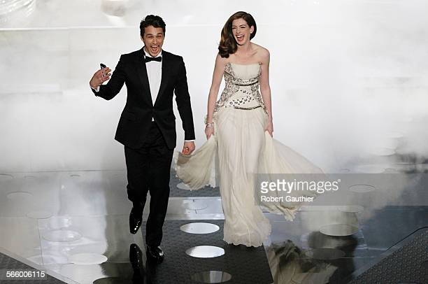 James Franco and Anne Hathaway enter the stage during the 83rd Annual Academy Awards at the Kodak Theatre in Los Angeles CA on February 27 2011