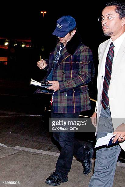 James Franco carries a book at LAX on September 16 2013 in Los Angeles California