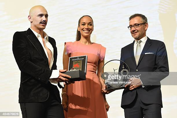 James Franco poses with his award for JaegerLeCoultre Glory to the Filmmaker 2014 Carmen Chaplin and Laurent Vinay Director of International...