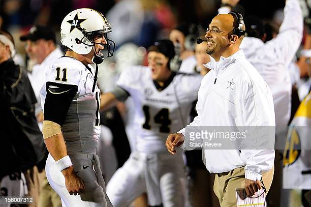 James Franklin head coach of the Vanderbilt Commodores and quarterback Jordan Rodgers celebrate a late score against the Ole Miss Rebels during a...