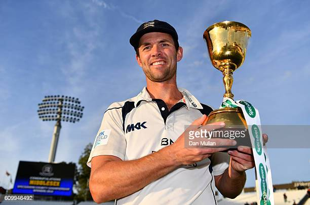 James Franklin of Middlesex poses with the County Championship Trophy following victory during day four of the Specsavers County Championship match...