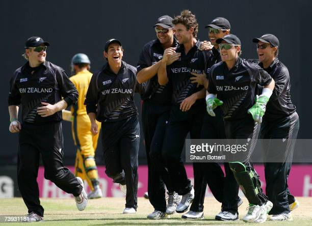 James Franklin of Nrew Zealand is congratulated by teammates after taking the wicket of Adam Gilchrist of Australia during the ICC Cricket World Cup...