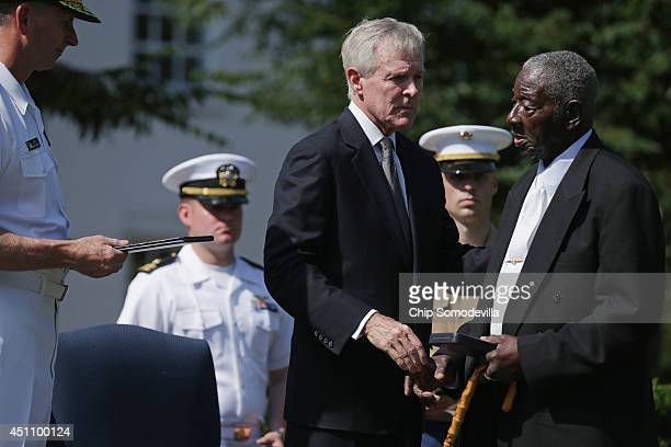 James Frasier accepts the Distinguished Civilian Service Medal on behalf of Sylvia Renee Frasier from US Navy Secretary Ray Mabus during an award...