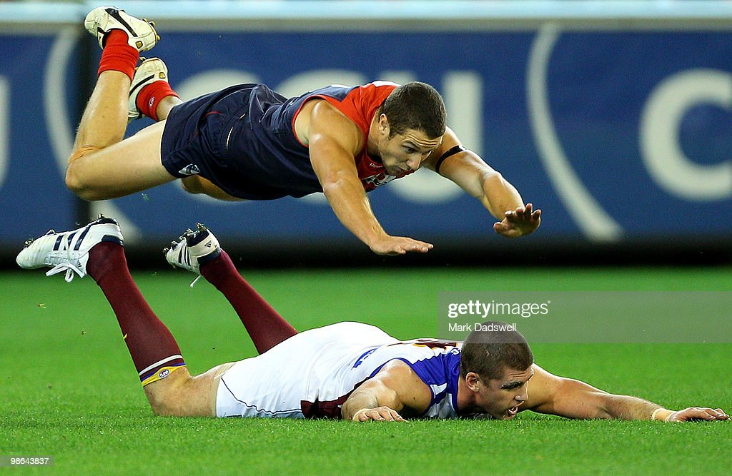 James Frawley of the Demons dives over Johnathan Brown of the Lions during the round five AFL match between the Melbourne Demons and the Brisbane Lions at Melbourne Cricket Ground on April 24, 2010 in Melbourne, Australia.