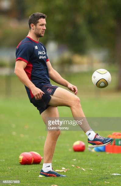James Frawley of the Demons kicks the soccer ball during a Melbourne Demons AFL training session at Gosch's Paddock on April 8, 2014 in Melbourne,...