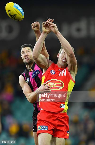 James Frawley of the Hawks spoils a mark by Tom Lynch of the Suns during the round 14 AFL match between the Hawthorn Hawks and the Gold Coast Suns at...