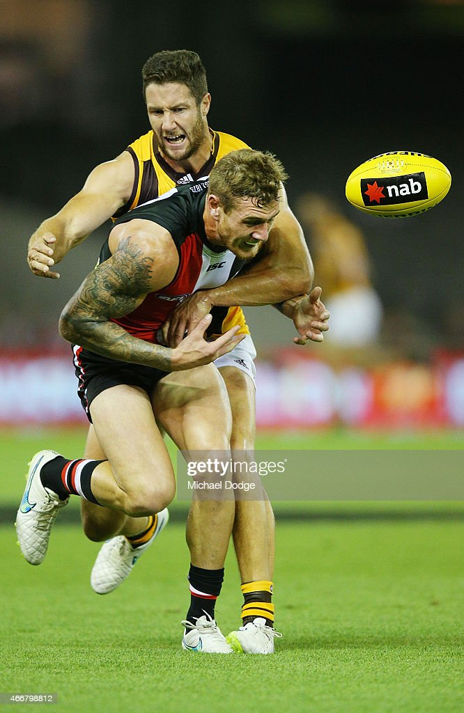 James Frawley of the Hawks tackles Tim Membrey of the Saints during the NAB Challenge AFL match between St Kilda Saints and Hawthorn Hawks at Etihad Stadium on March 19, 2015 in Melbourne, Australia.